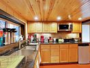 Kitchen  - The kitchen is fully equipped with essential cookware.
