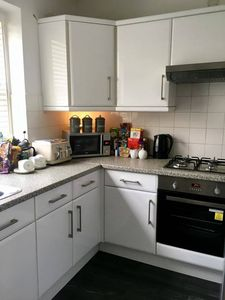Modern kitchen with all appliances including kettle and toaster .