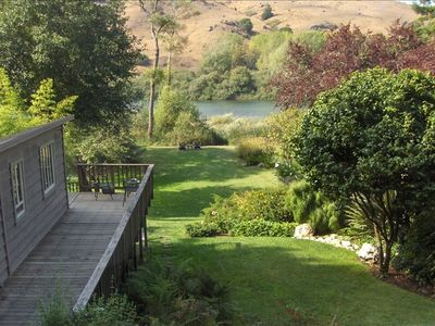 View from master suite of cottage, large lawn & river