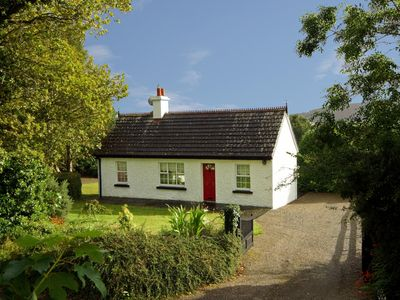 Photo for Most attractive cottage, in private hillside location on quiet country road with mountain view…