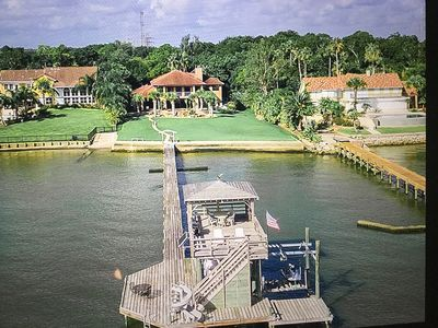 Photo for Gulf-front Estate with waterfront views. Walk to Boardwalk Lots of garden games