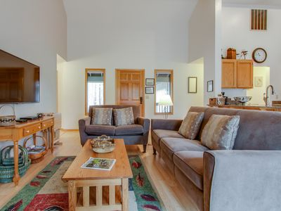 Photo for Bright, modern home with private hot tub - central location, free SHARC access!