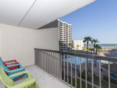 Photo for Bright Beachfront Condo with Balcony overlooking Tropical Grounds, Multiple Pools & the Gulf of Mexico!
