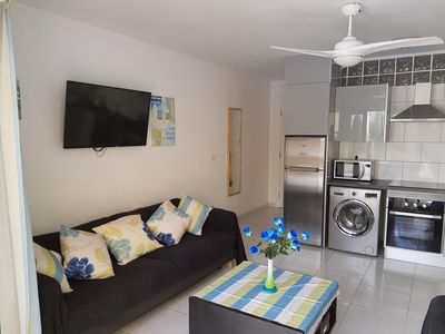 """Kitchen/Living Room with wall mounted 42"""" TV"""
