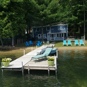 Photo for Stay at this adorable cottage that is just feet away from the beach and lake!