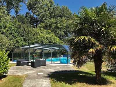 Photo for Villa all on the ground floor with WIFI, private swimming pool under top shelters in PLEUMEUR-BODOU
