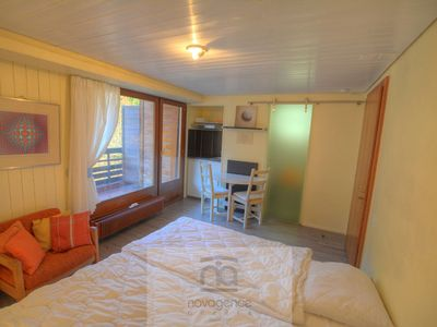 Photo for North studio with 1 bathroom/WC and living room with 2 single beds, 1 low table and 2 armchairs. The