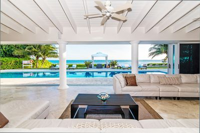 Villa Mora features open architecture and large sliding glass doors to the pool deck.