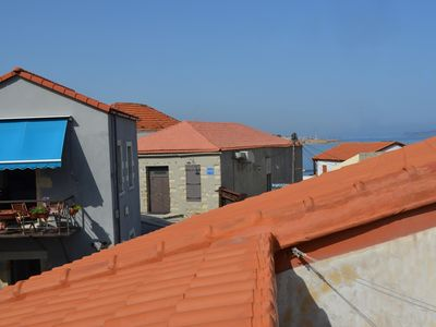 Photo for Loft Chania, at the water edge with view on the Cretan sea