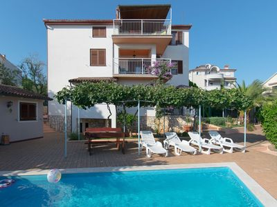 Photo for Seaview spacious apartment with use of pool, airco, WiFi, bbq, fenced garden