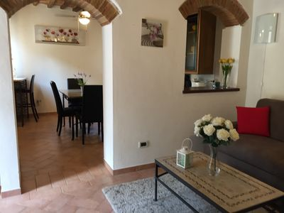 Beautiful Arches and Wood Beams throughout apartment