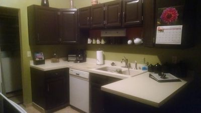 Fully equipped dkitchen with KitchenAid dishwasher, coffee maker & toaster.