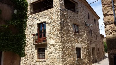 Photo for Stone house of 3 floors, rustic in quiet street, 200m2,