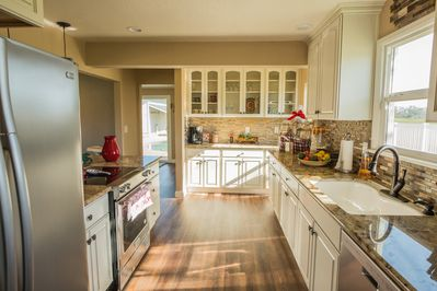 Newly renovated kitchen with gorgeous cabinets that offer plenty of storage.
