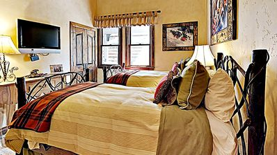 Photo for Luxurious mountain condo with ski-in/ski-out access and shared pool/hot tub