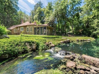 Photo for Enchanting storybook cottage  on beautiful property with babbling brook