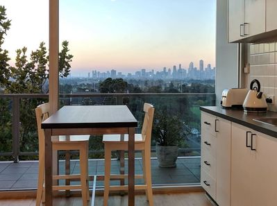 Kitchen with sunset views over Melbourne CBD