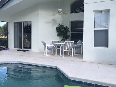 Photo for Only four miles from Disney! 4 beds, 3 baths, private pool and spa