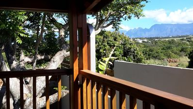 Photo for Pretty wooden cottage in tropical garden