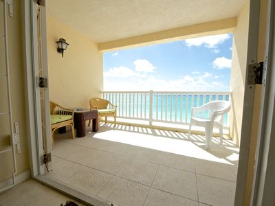 Photo for Beachfront 2 BR Apartment with oceanfront balcony in Maxwell Coast Road