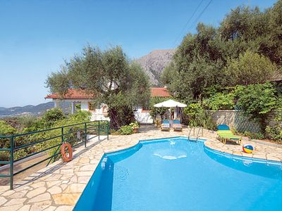 Photo for Stunning coastal villa w/ views, pool, aircon, Wi-Fi and nearby beach.