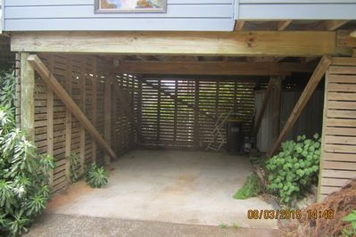 Carport for storage with second fridge/freezer.