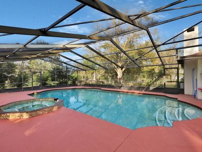 Photo for Family-friendly home on an acre w/ a private pool & covered lanai!