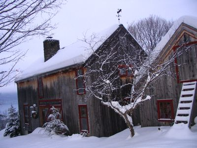 Barn house in winter, mountains in distance
