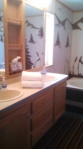 Both bathrooms have 2 sinks,  large garden tubs and separate showers.