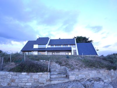 Photo for Large house overlooking the beach with 180 ° views of the ocean.