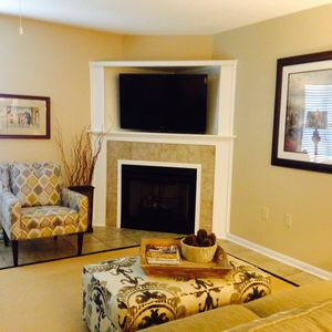 Warm and inviting living area with seating for six. TV comes with DirecTV.