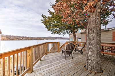 """A rejuvenating retreat awaits you at 'The Far Out Cottage,"""" a lakefront vacation rental studio cottage in Camdenton!"""