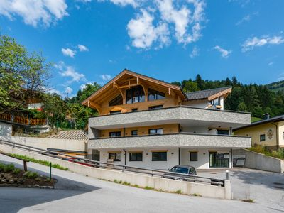 Photo for Luxurious ski-in ski-out penthouse, right on the slope in beautiful Alpendorf