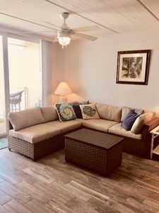 Living room with sectional couch and storage ottoman