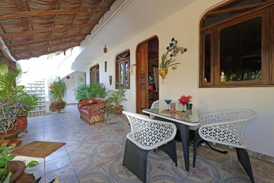 Entrance porch leading to stairs to Villa. Beach shower beneath stairs.