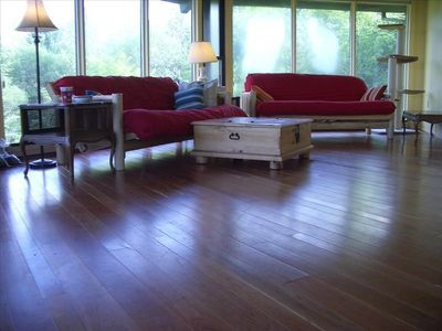 Relax in the sitting room with cherry flooring