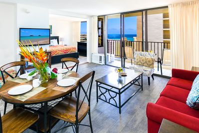 Living room and dining area with ocean views