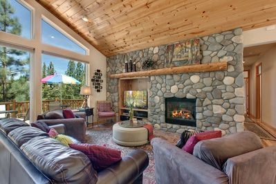 RIVER ROCK FIREPLACE FOR COZY GATHERING
