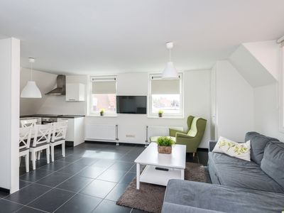 Photo for 6-person apartment with lovely, sunny, private roof terrace in the heart of Ouddorp