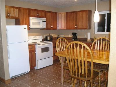 Full size appliances and well stocked cupboards make this a kitchen you can use!