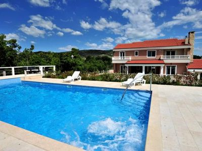 Photo for Modern and luxury house, five bedroom, outdoor pool and barbecue, free parking