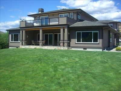 Beautiful lawn, flagstone patio, and view deck - TWO master suite wings