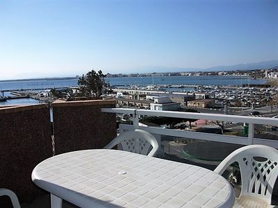 Photo for Well it located in front of the fishing port of Roses, very sunny and with fantastic views