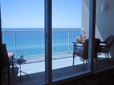 UNWIND: the big 17' balcony has 2 comfy chaises and a seating group for 4