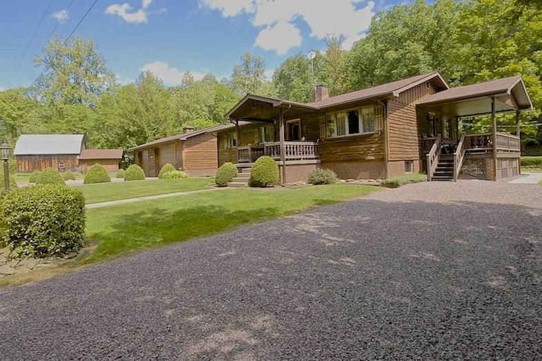 OVR's Whispering Pines!Lush estate with trout stream, game room & large yard!