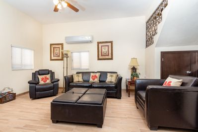 Downstairs living area with no TV.  Open to kitchen. Queen sleeper sofa