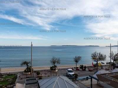 Photo for Le Lavandou facing sea, building of good standing feet in the water. Near center and shops