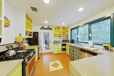 Kitchen - Appliances include a 4-burner gas stove and dishwasher.
