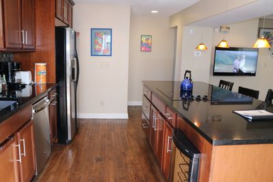 Fridge, wine cooler, dishwasher, glass cooktop, microwave, oven, coffepot kettle