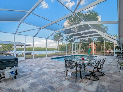 Photo for Waterfront Pool Home with Boat Dock and Screened Patio!  Real Florida Salt Life!